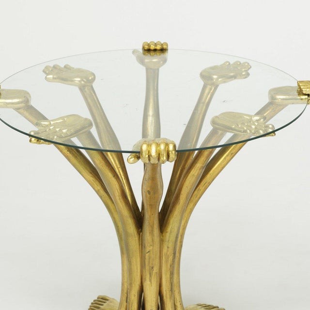 Hand-foot gilt-wood and glass top sculptural side table by Pedro Friedeberg, Mexico, 1970s.
