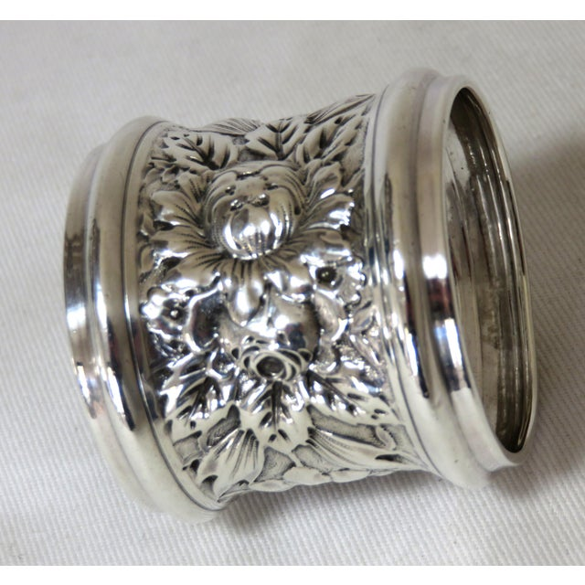A Large Size Antique Sterling Silver napkin Ring. Fancy Hand Repousse Floral Decorations. Made by the Gorham silver...