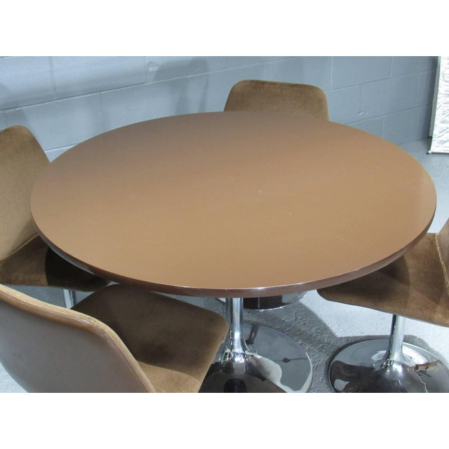 Chrome tulip table and four chairs with brown fabric. Label: Johanson Design. A stunning retro dining set by Borje...