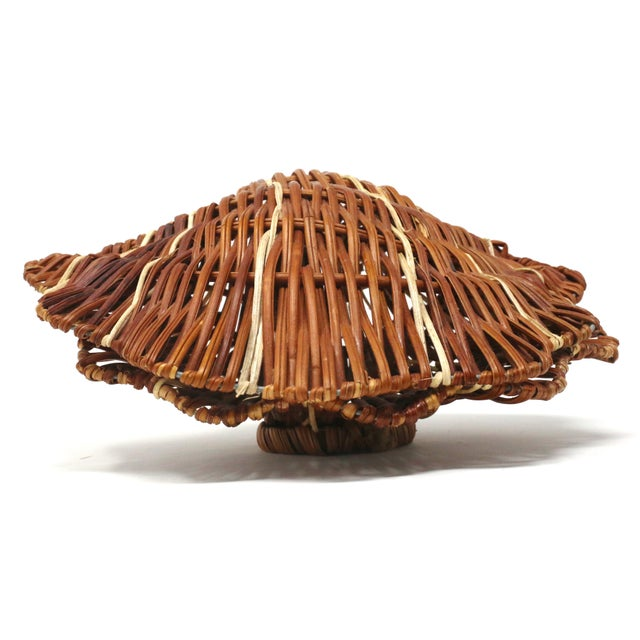 A vintage wicker box, in the form of a scallop or clam shell. Good vintage condition; minor wear.