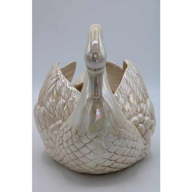 This is a cream lusterware swan cachepot or planter, made in Holland circa 1940. This is a detailed piece, in excellent...
