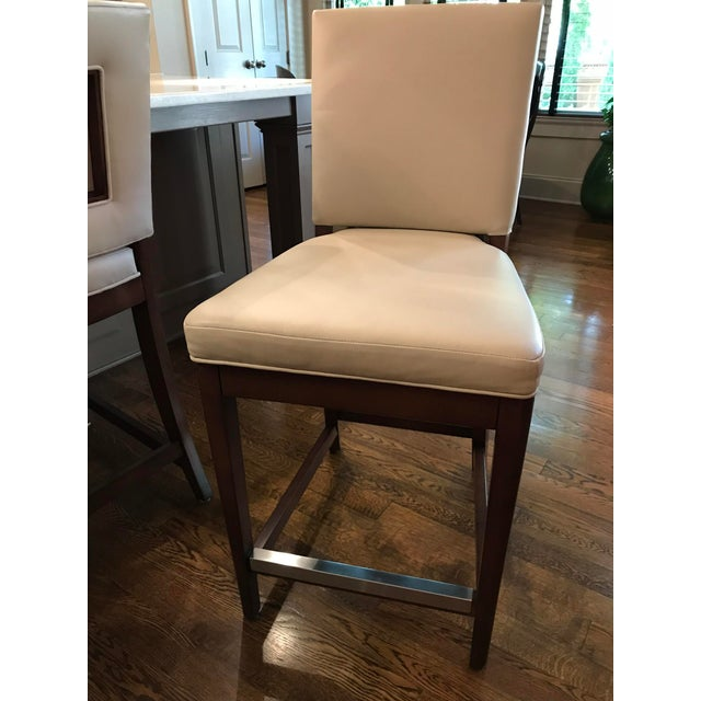 Comfortable and elegant in a classic silhouette with wooden details in back! These custom Vanguard Juliet Counter stools...