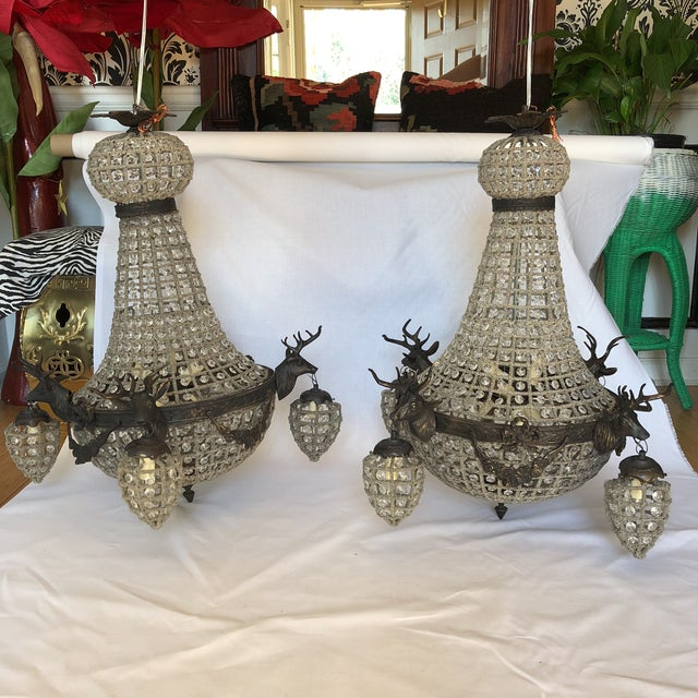 A gorgeous dark charcoal bronze deer head chandeliers. Perfect for a dining table or interior design space. French and...