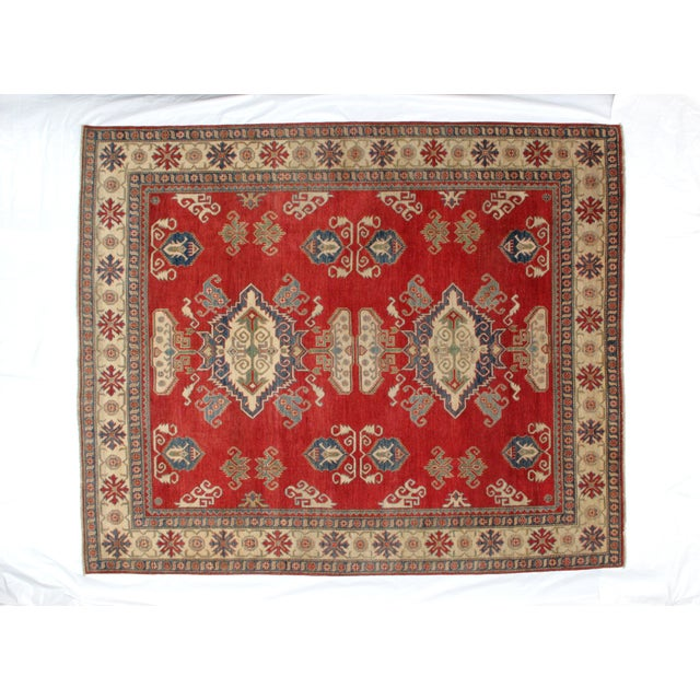 Wool pile hand made Kazak carpet in mint condition.