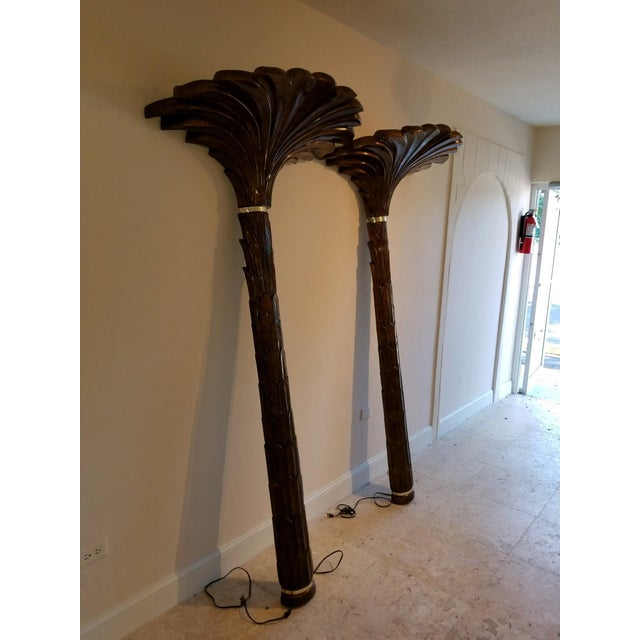 Undoubtedly inspired by the work of Serge Roche, these torchieres are designed to mount to a wall for support. The body is...