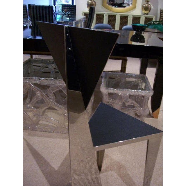 This is such a sculptural chair - Italian 1970's with sharp angles and mirror finish stainless steel.