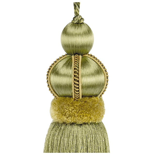 Olive green satin covered key tassel is made with a cut velvet ruche & decorative gimp and has a twisted cord detail....