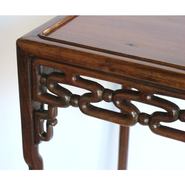 Asian A richly patinated Chinese hongmu wood square side table with stylized openwork cloud-scroll apron and spandrels For Sale - Image 3 of 5