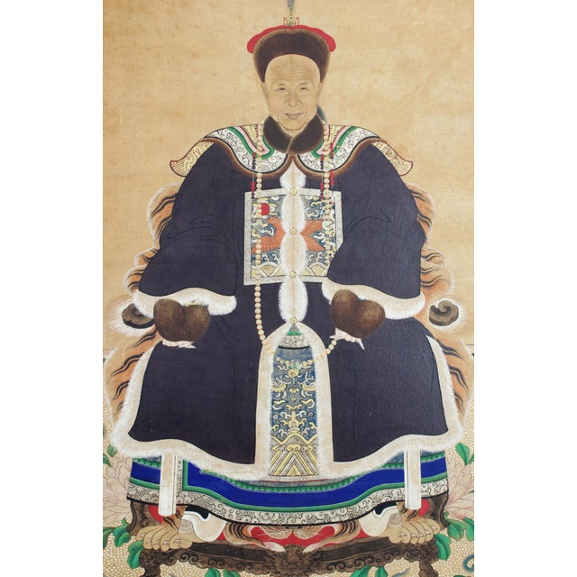 This is a Chinese ancestral portrait painting from the late 19th century. The piece depicts a gentleman in a black fur-...