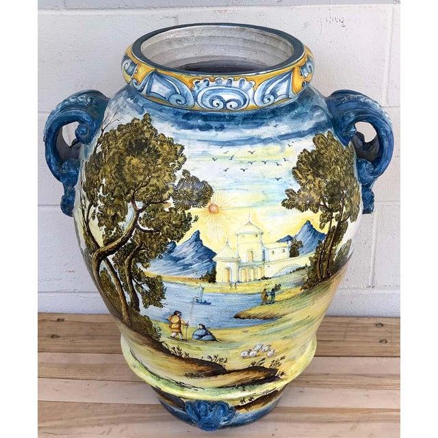 Italian Majolica landscape olive oil jar/ jardinière, Provenance: Celine Dion Profusely decorated with a Renaissance style...