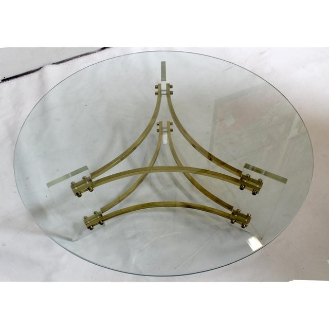 Brass and acrylic coffee table, circa 1980's. Designed by Charles Hollis Jones. Light wear to brass and lucite . Glass top...