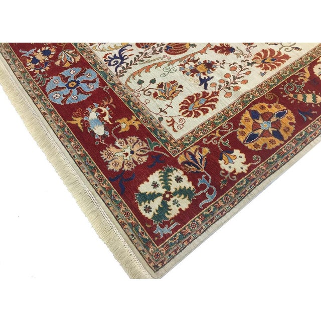 This monarchial hand knotted rug has been made with lustrous wool with 100% vegetable dyes in a striking combination of...