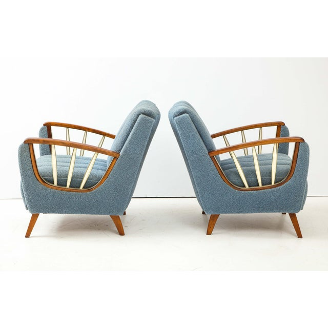 Pair of German 1950's walnut armchairs, the open armrests supported by three brass and resin decorative slats. Upholstered...