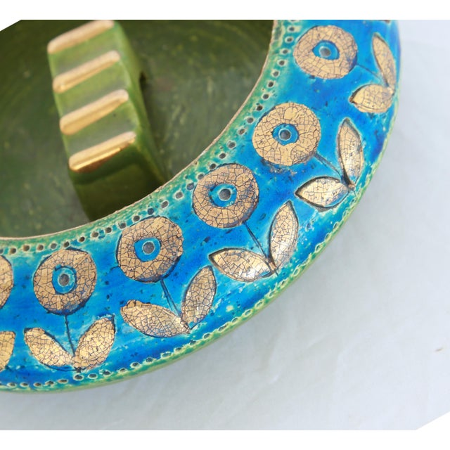 Mid-century Rosenthal ceramic ashtray glazed in vibrant turquoise blue and acid green accented with 22K gold flowers.
