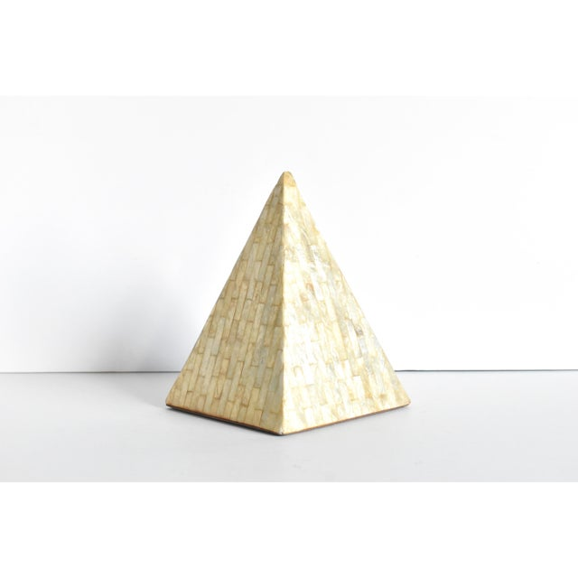 A vintage pyramid inlaid with capiz shell mother of pearl. Velvet base.