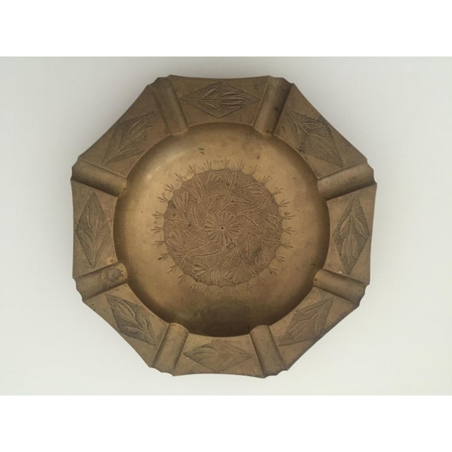 This vintage Mid Century large octagon shaped India solid brass engraved etched design ashtray is a very special and...