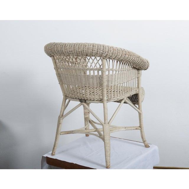 Wicker armchair painted designed by Hans Vollmer about 1900 in Vienna for Prag-Rudniker Korbwaren-Fabrication. Original...