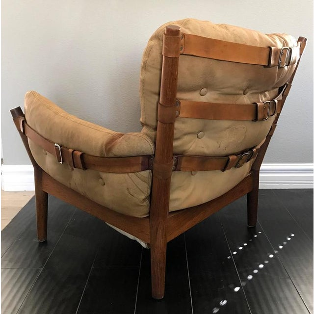 A rare low-slung easy chair by John Mortensen for Magnus Olesen (Denmark). This stunning lounge chair appears almost as a...