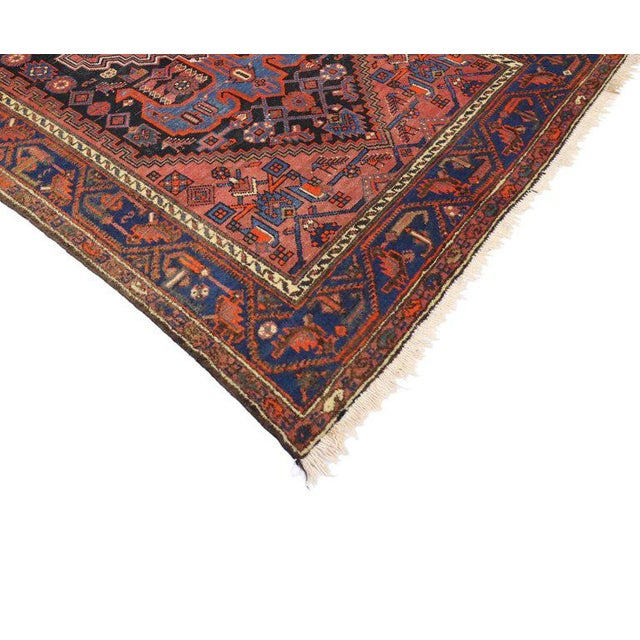 Set off with its Classic, yet modern aesthetic and sophisticated level of contrast, this antique Persian Hamadan rug with...