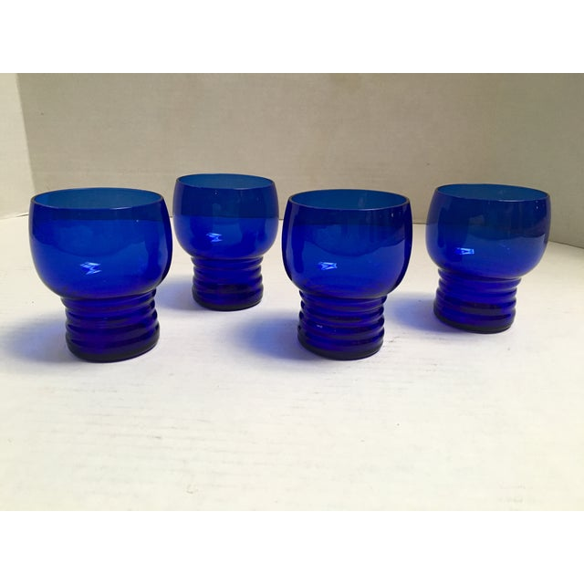 Set of four, vintage cocktail glasses featuring Art Deco-inspired, ribbed-bottoms. The gorgeous, deep blue cobalt color...