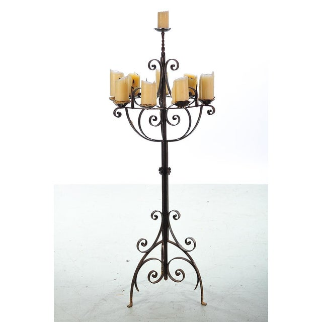 Spanish Revival Wrought Iron 8 Arm Candle Holder Torchieres. A beautiful piece that will add to your décor!
