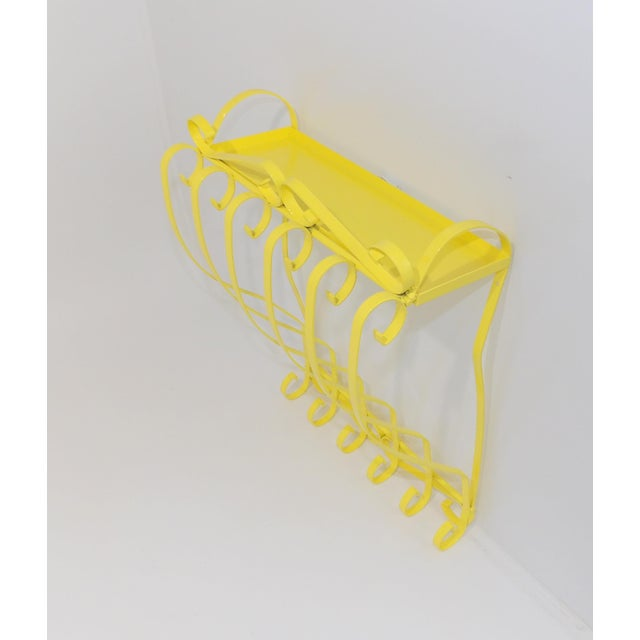 Beautiful wrought iron wall shelf. Painted an electric yellow gloss. Perfect for your bathroom, office or patio decor....