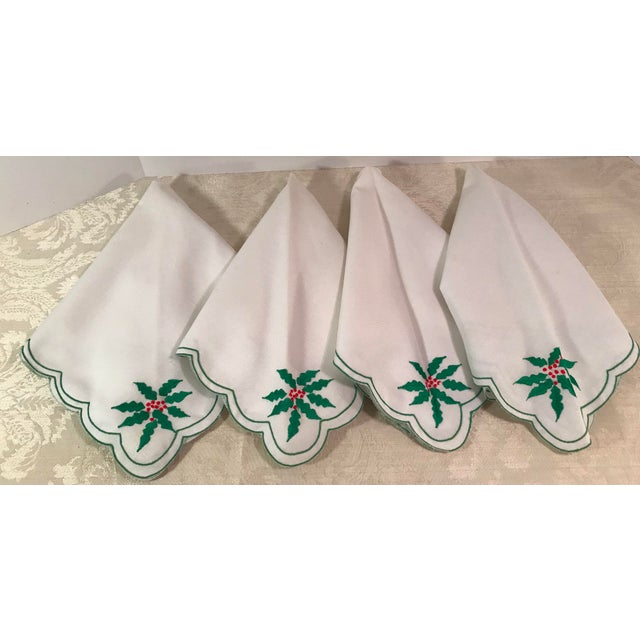 Nice vintage set of Christmas napkins with green and red corner Poinsettias on a white background. Really nice. A faint...