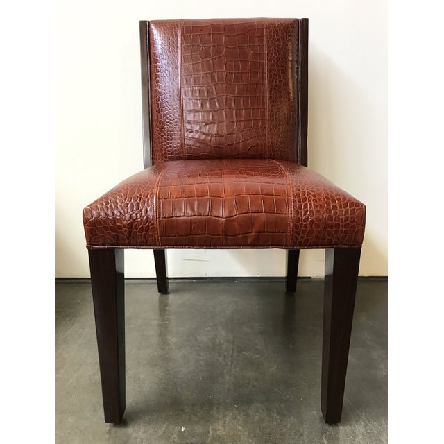Side chair upholstered in saddle brown alligator embossed leather; rosewood legs. Additional dimensions: Seat height 19H