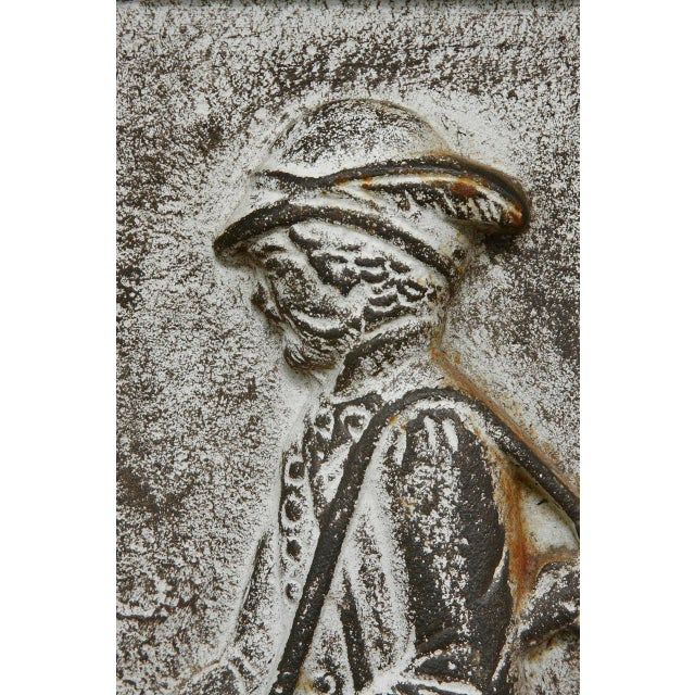 Impressive 19th century cast iron hunt plaque or fireback. Depicts a hunter and his dog in high relief cast iron with a...