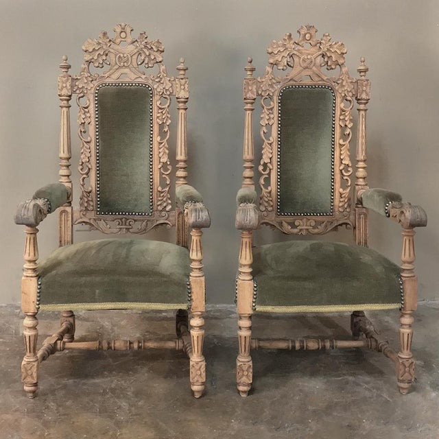 Pair 19th Century Black Forest Stripped Oak Armchairs is a superlative testament to the talents of the regional sculptors,...