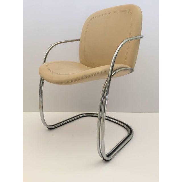 Gastone Rinaldi chrome and beige leather armchairs, set of four. Gastone Rinaldi for RIMA, circa 1970s, he designed a...