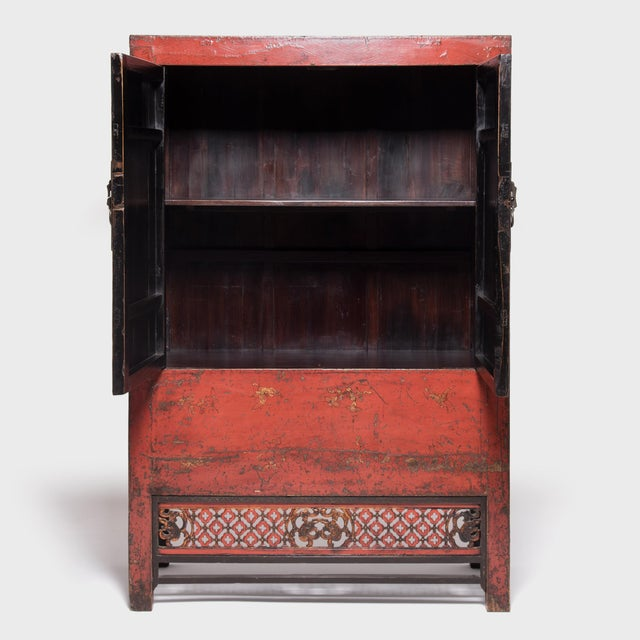This red lacquer cabinet is an excellent example of the rich, decorative style of cabinetry built during the 19th century...