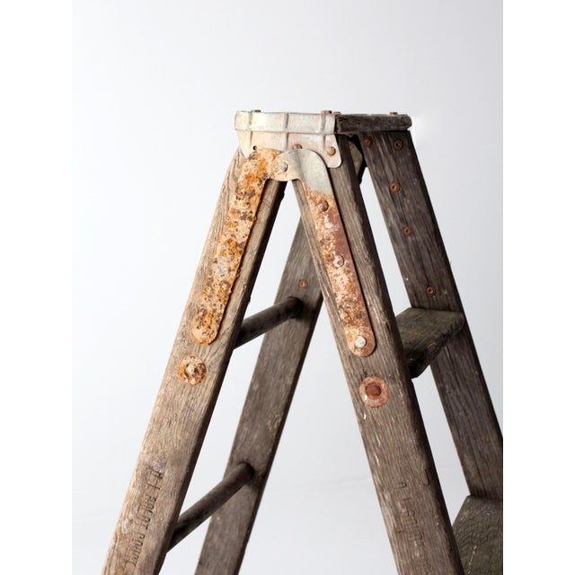 This is a vintage wooden folding ladder. Hang textiles and towels, or use as shelf, this old painter's ladder has great...