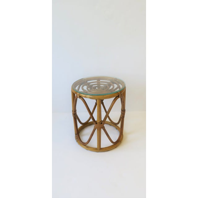 A chic small round wicker rattan bentwood stool, side or drinks table with glass top, in the style of Franco Albini....