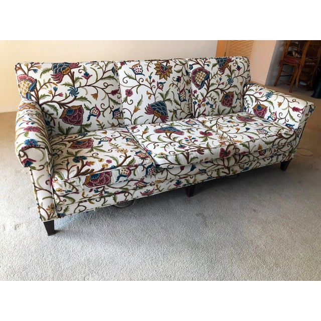 This is a fabulous mid-century modern, rolled arm, three-seat sofa with great lines. It's currently upholstered in a...