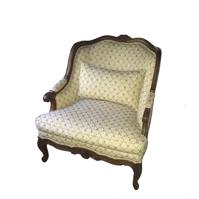 Lillian August for Drexel oversized wide Bergere Chair. Beautifully detailed carvings combined with a warm cherry patina...