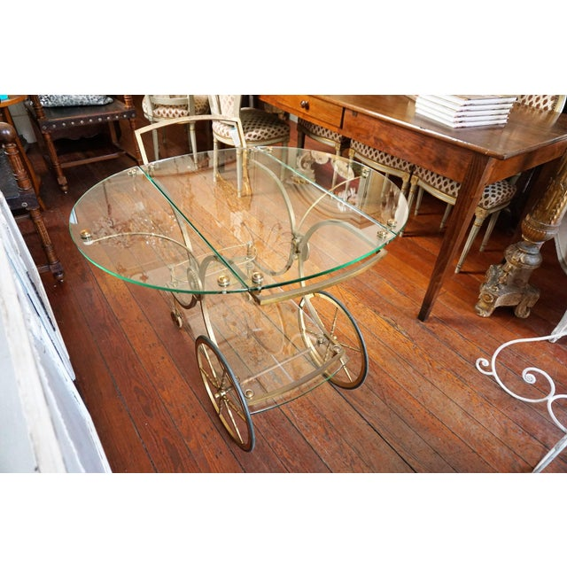 The most adorable service cart from France in glass with drop leaves , bottom glass shelf, two big brass wheels and two...