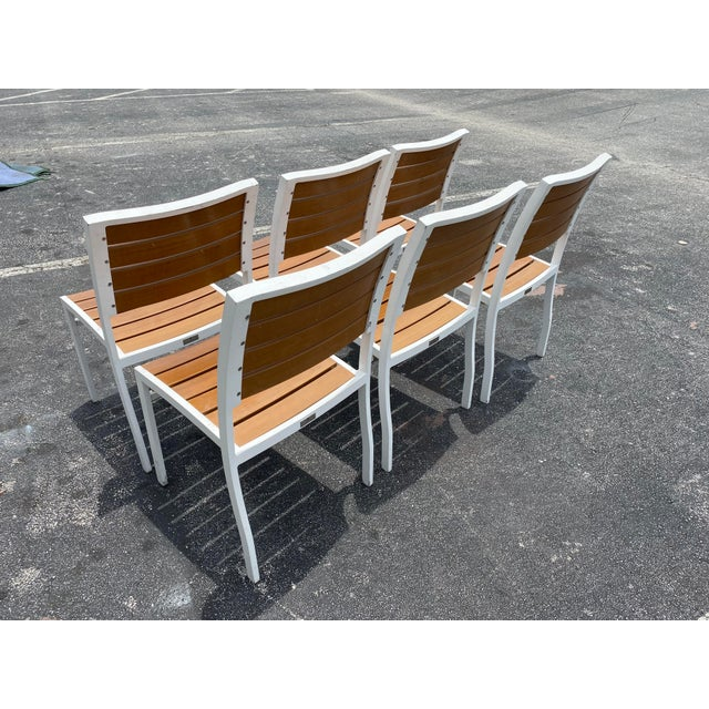 Fantastic vintage set of Janus et Cie dining chairs. Set of 6. Made of Aluminum that is painted white and wood grain....