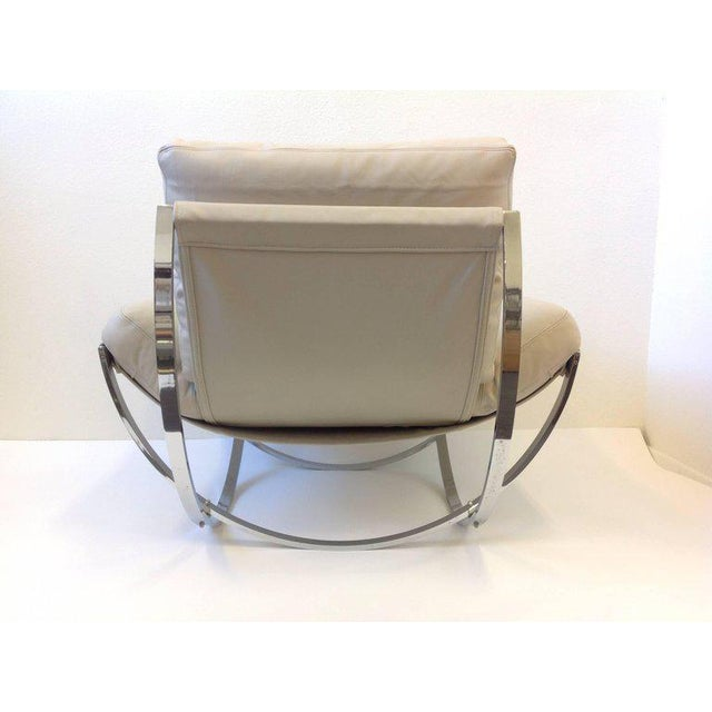 A amazing 1970s Italian lounge chair and ottoman by Stendig. The chair is constructed of solid polish stainless steel and...