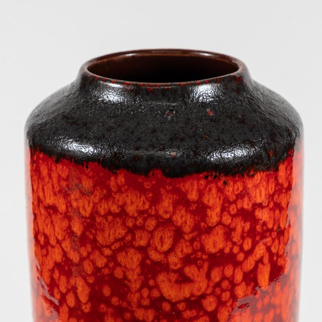 A mid century glazed ceramic pottery vase with a textured finish from Germany. It features an interesting marbled finish...