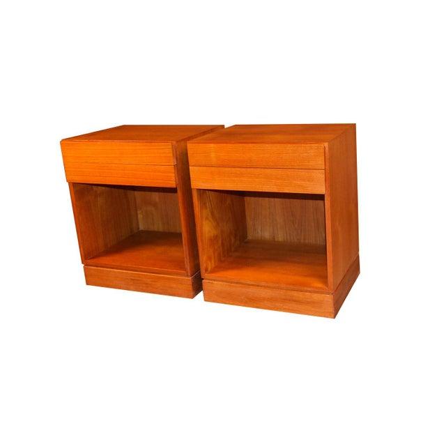 These Scandinavian Modernist, teak Danish tables were produced in Denmark by Vinde Mobelfabrik and designed by Arne Wahl...