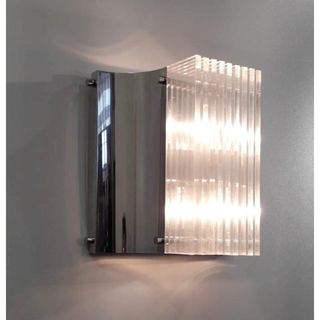 Italian mid-century Lucite wall lights mounted on polished chrome frames / Made in Italy circa 1960s 2 lights / E12 or E14...