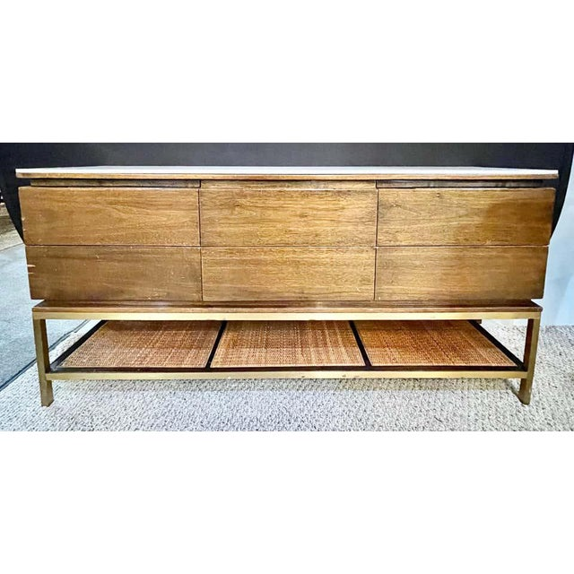 Mid-Century Modern drawer cabinet with glass top brass frame and caning. This finely crafted cabinet is perfect for a...