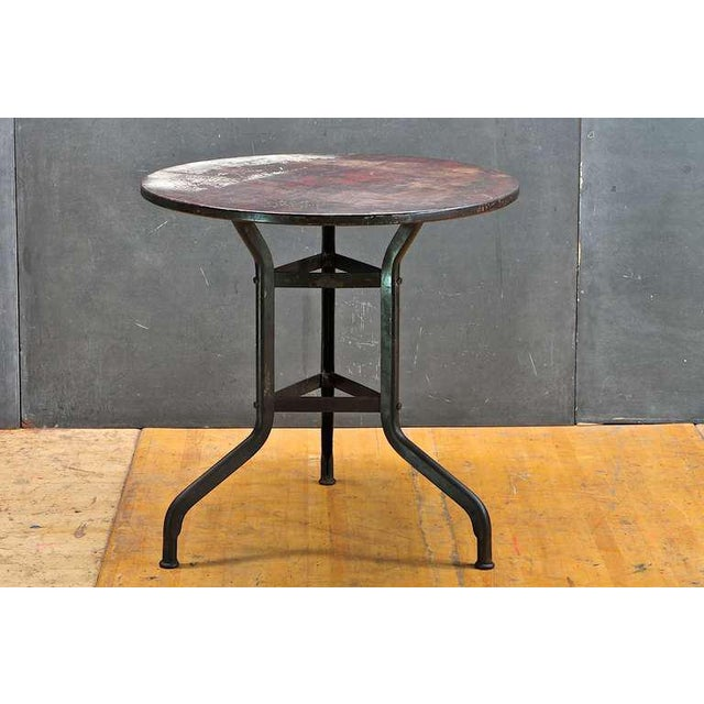 All original, with the original staved old growth hardwood round top heavily Patina'd, on time worn black enameled steel...