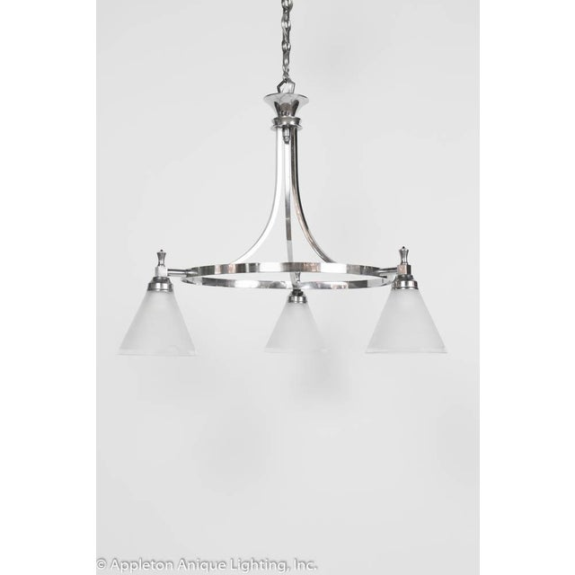 "Three lights, frosted original shades. French. Chrome finish with frosted glass. Fixture only is 21"", setup with chain to..."