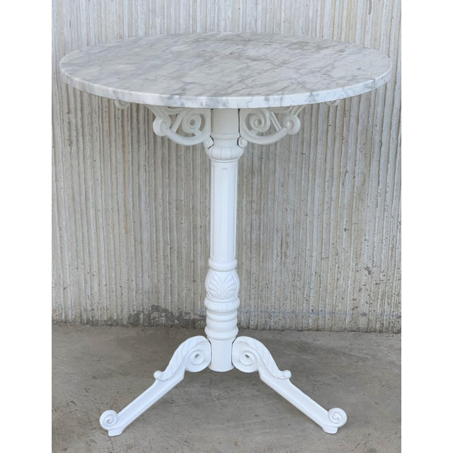 About French style cast iron base with marble top garden table or bistro table. Finely detailed cast iron base with white...