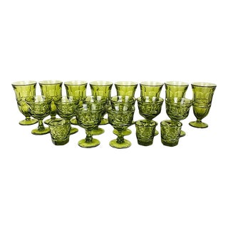 Faceted Avocado Green Kings Crown Indiana Thumbprint Stem Glasses - Set of 19 For Sale