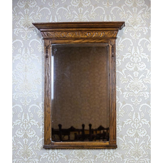 We present you a big Neo-Renaissance mirror in an oak frame. It is from Q4 of the 19th century. The frame is topped with a...