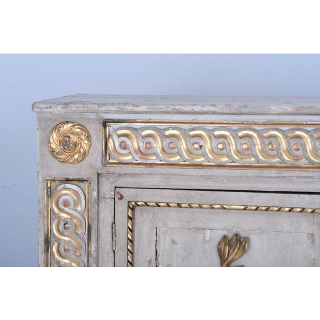 This listing is for a regal 18th century neoclassical sideboard cabinet with its original parcel-gilt in tact. This piece...