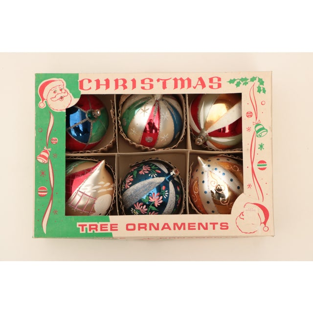 Set of six mid-century Polish blown glass Christmas tree ornaments decorated with glitter and hand painted detail. Very...